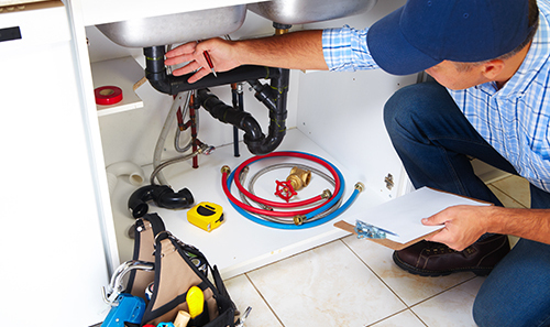 Versatile plumber performing kitchen pipe repairs in Hilo, HI