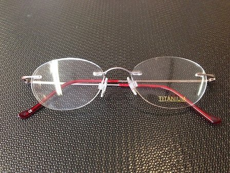 reading glasses with red frame
