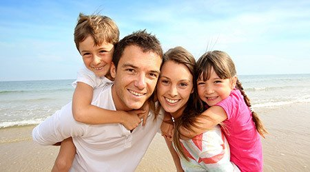 Happy family on beach after receiving loan in Christchurch