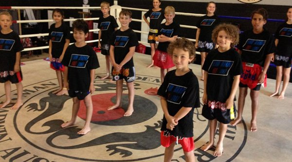 smiling martial arts class in ring