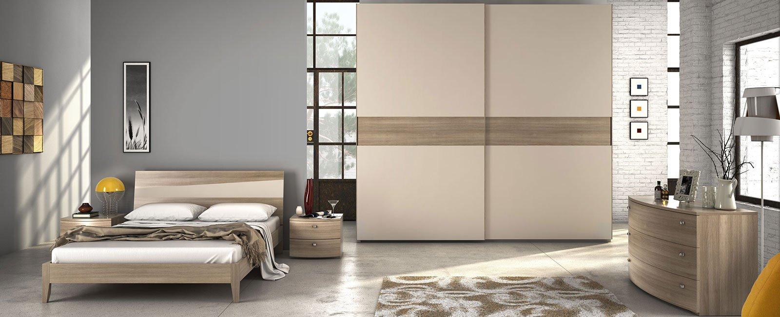 una camera da letto moderna con un letto,due comodini,un armadio e un comò beige