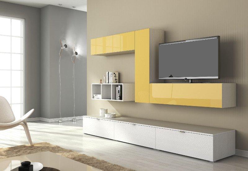 un mobile bianco e giallo con sopra una tv