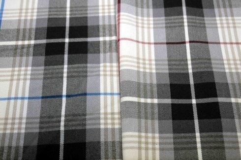 cambi tessuti abbigliamento stock