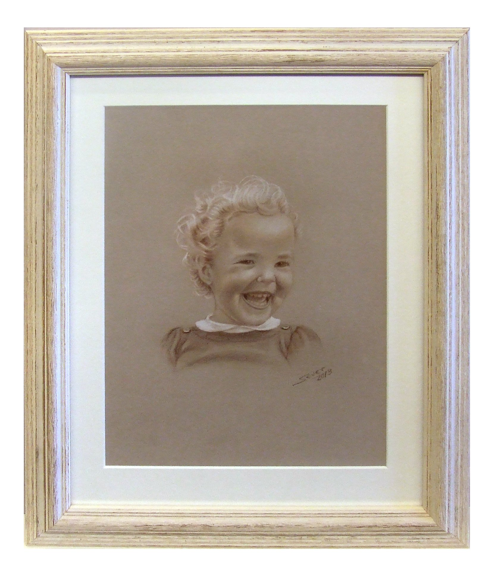 A canvas of a baby picture