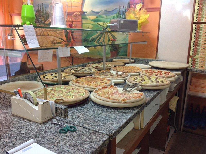 Diversi tipi di pizza alla pizzeria Scacco Matto in Perugia