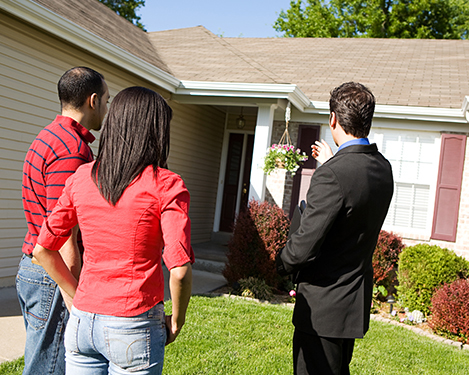 Real estate agent discussing with clients