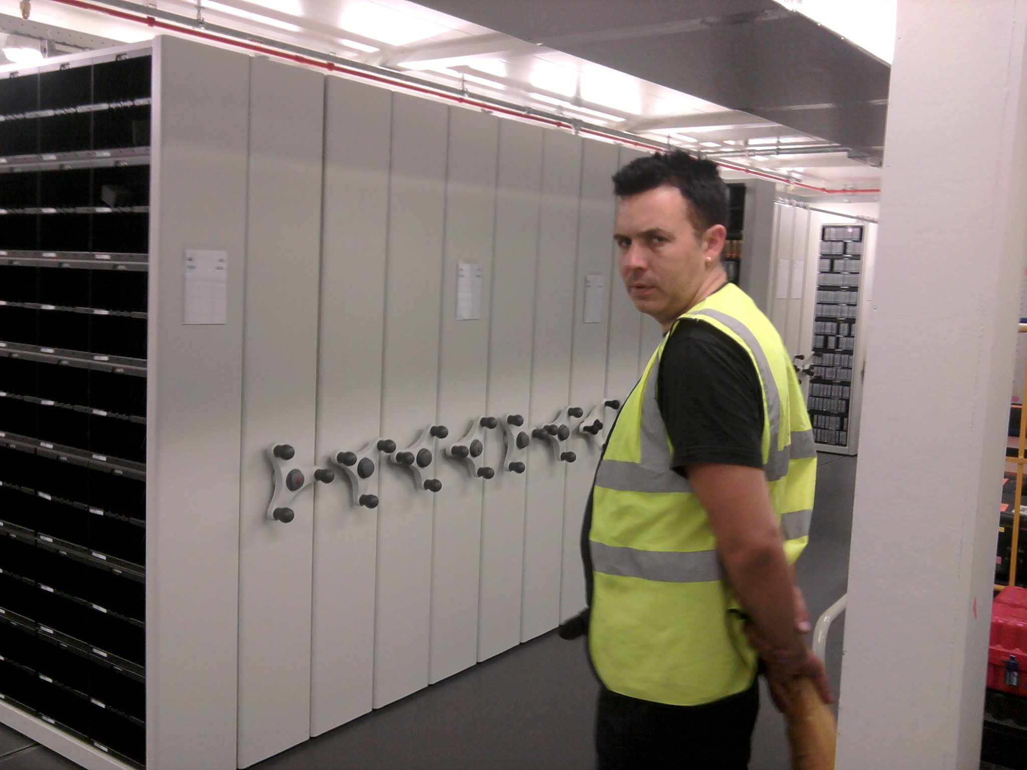 man outside storage lockers