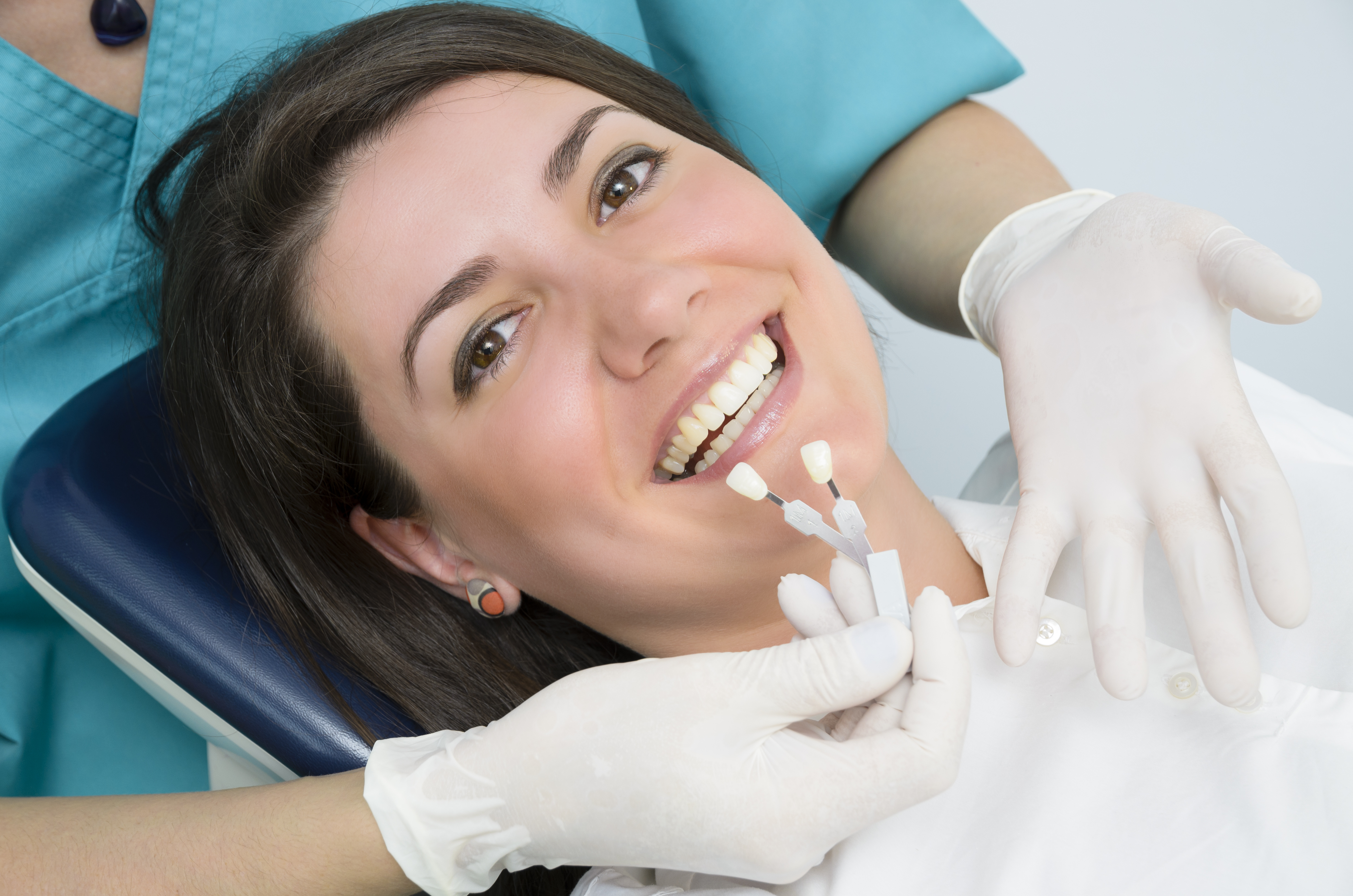 Woman at the dentist's office getting dental implants