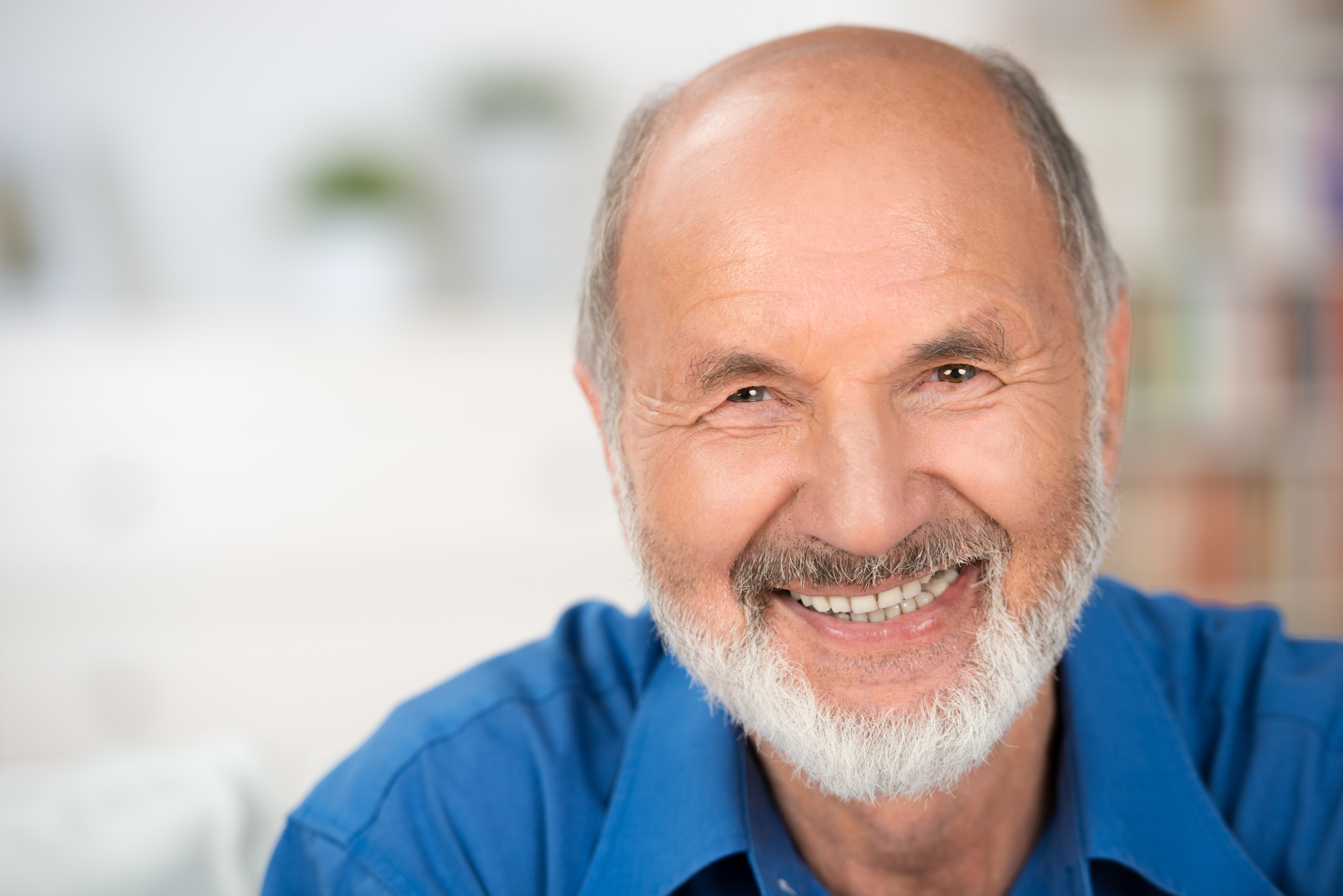 Man happy with his dental bridges