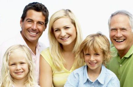 Smiling family happy with our dental services