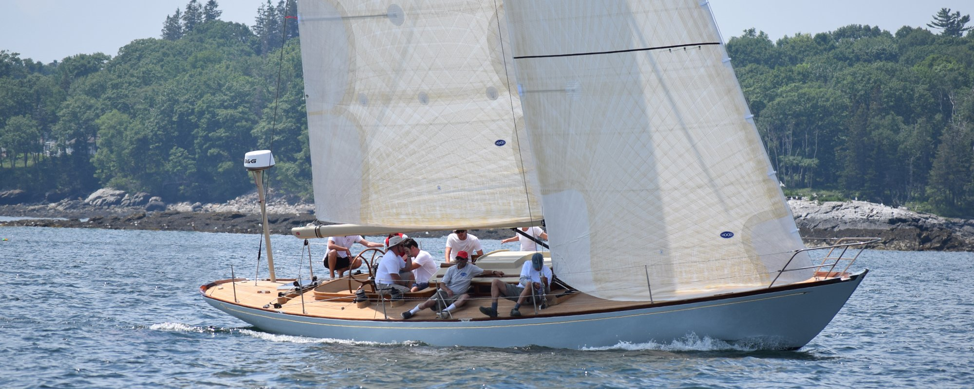 Group of friends enjoying time on a sailing boat