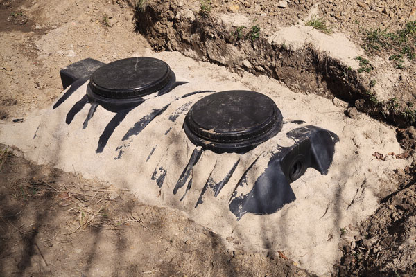 Septic tank buried in the ground