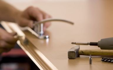 an old bar locksmith service man fixing lock and tools on the board