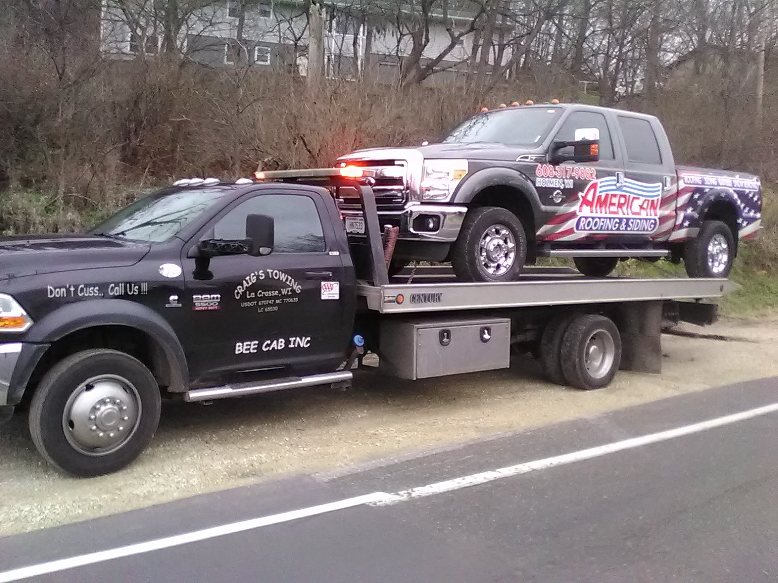 Tow truck towing a broken fleet vehicle