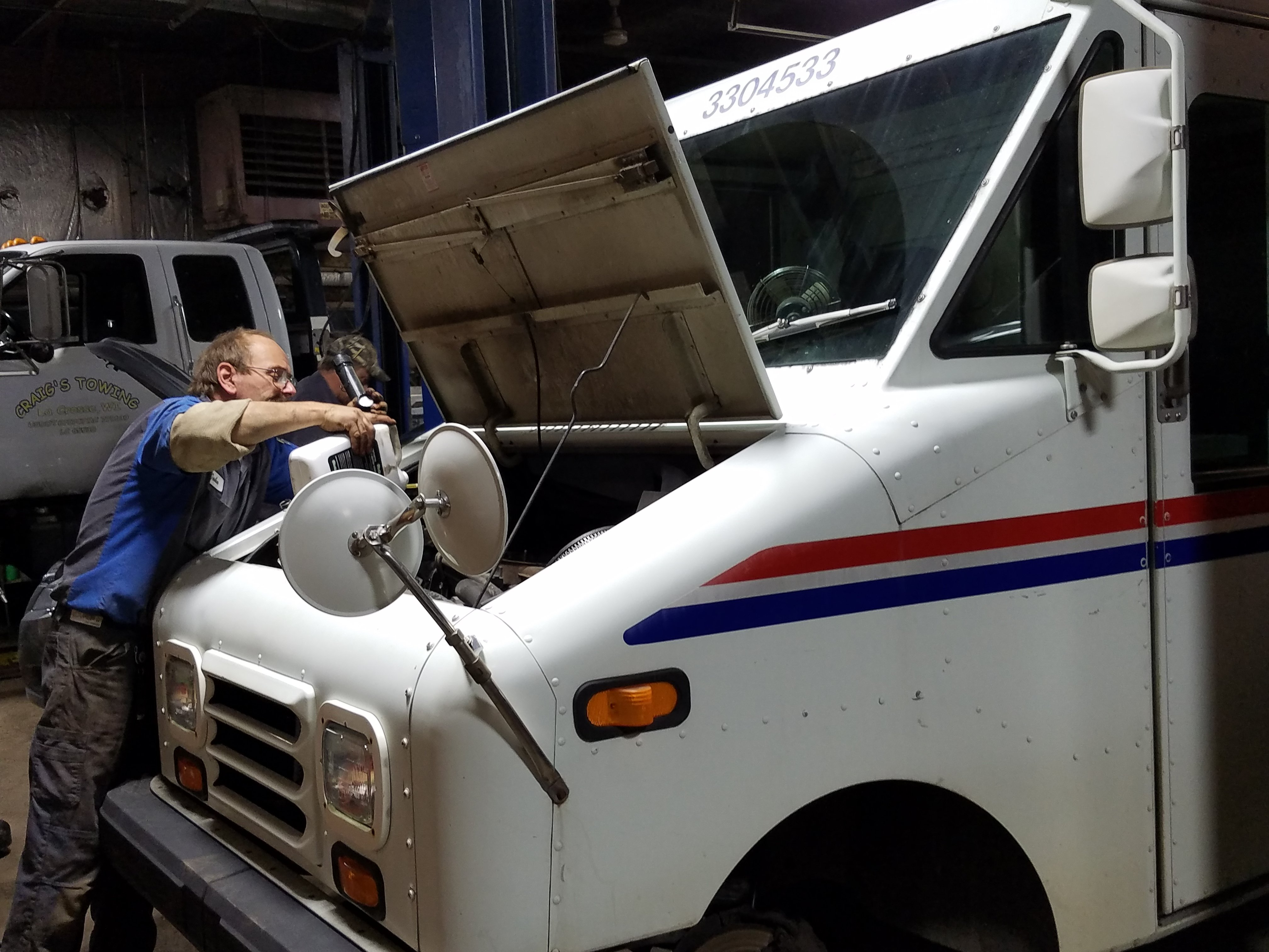 Mechanic working on a USPS vehicle
