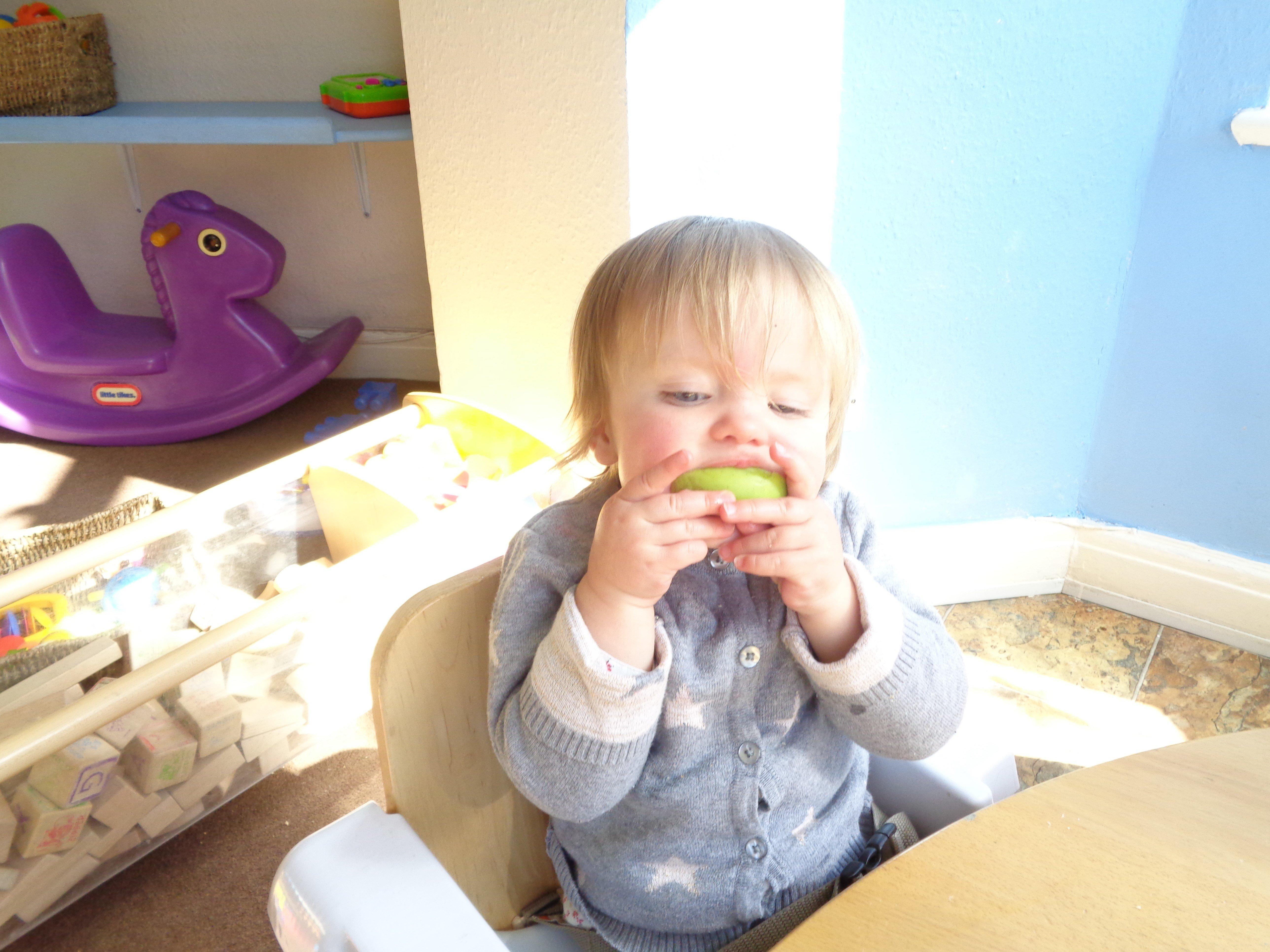 child eating a lemon