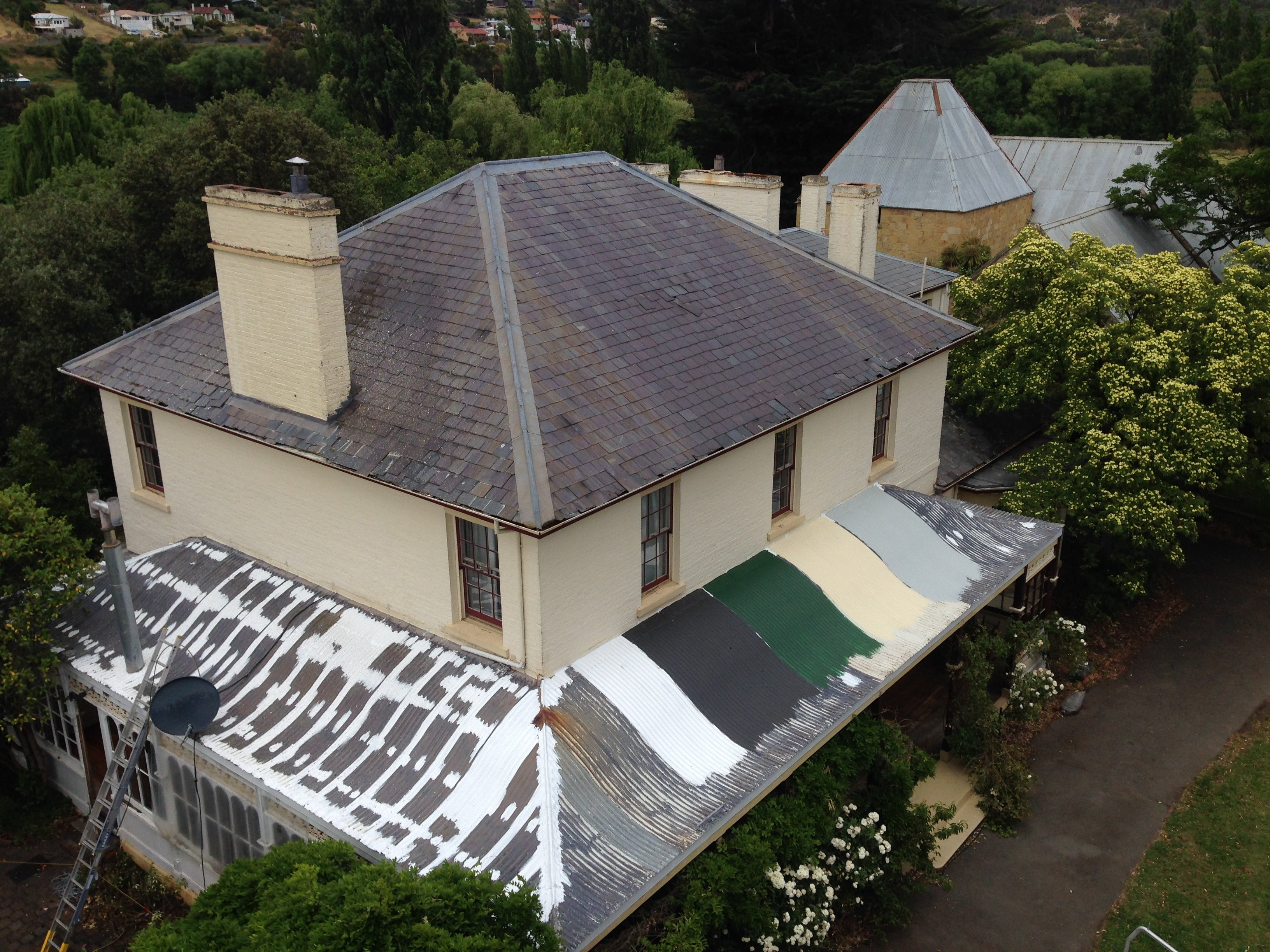 Ogee style colnial verandah roof Roof restoration repairs small cottage painting heritage and slate roofing hobart australia