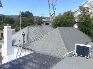 Roof restoration repairs grey roof heritage and slate roofing hobart australia