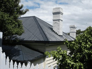 Roof restoration repairs white chimny on roof heritage and slate roofing hobart australia