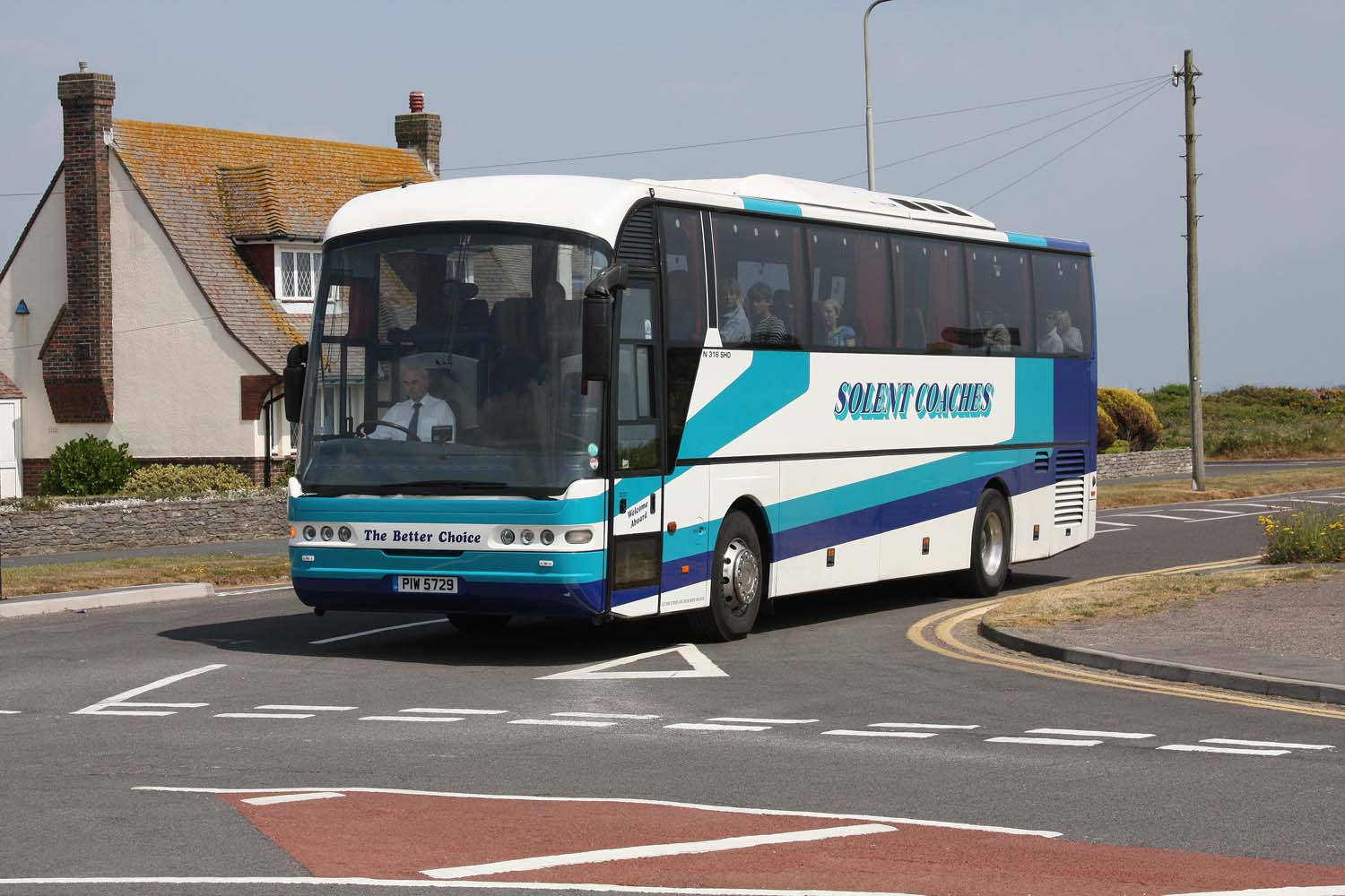 White and blue Solent bus