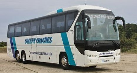 A white Solent bus with blue strips