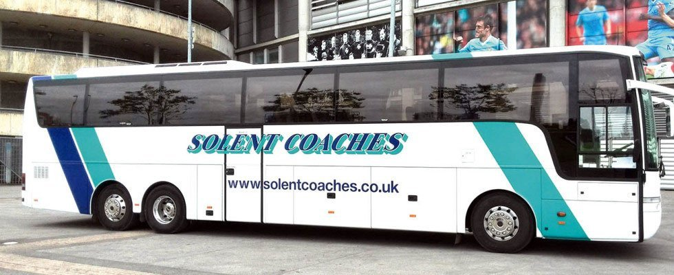 Solent bus waiting in a parking lot