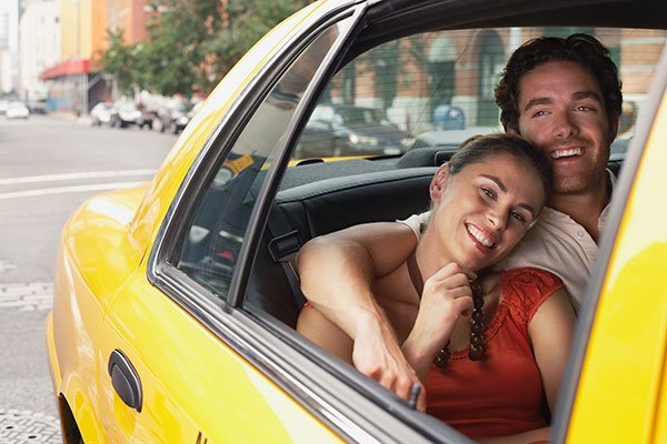 Young couple in yellow taxi