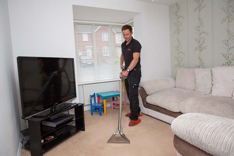 vacuum cleaning in the living room