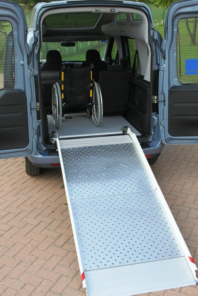 Transfer of disabled people on-board vehicles