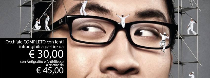 un uomo con un paio di occhiali da vista di color nero