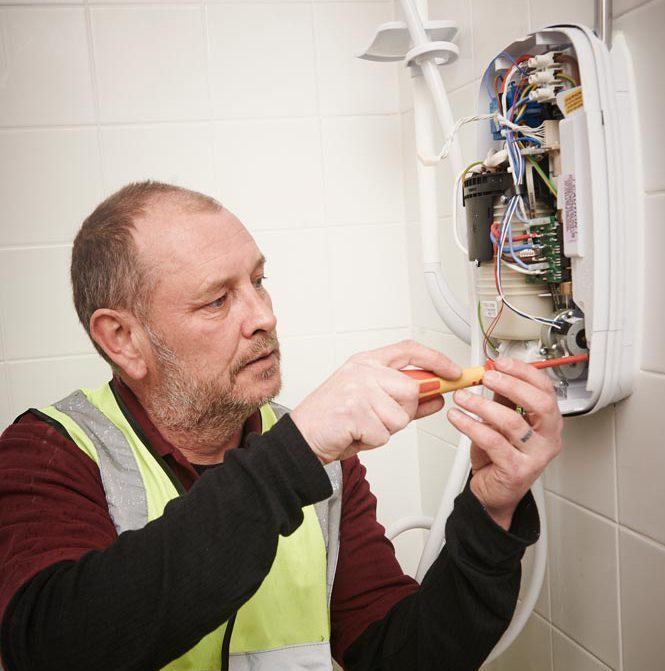 Employee working on new kitchens & bathrooms in The Wigan Borough