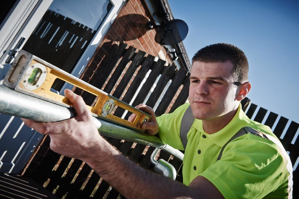 Maintenance and extensions specialist at work in The Wigan Borough