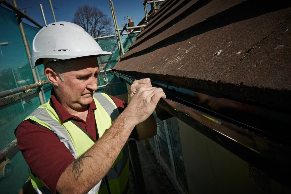 Experienced professional providing gutter repairing services