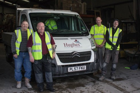 Team of professionals at Hughes