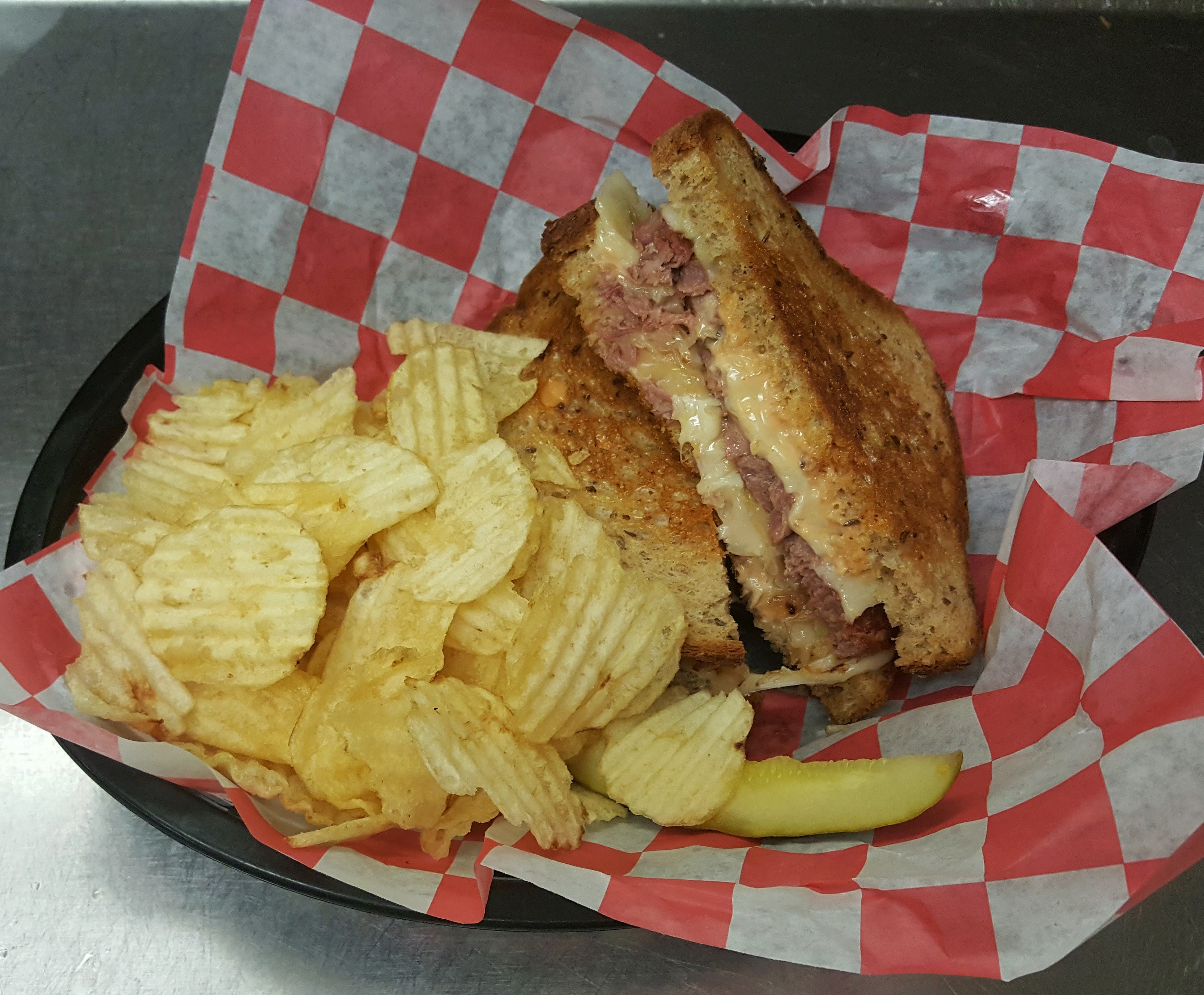 Tasty Reuben Melt Sandwich and Chips at the Conestoga Wagon.