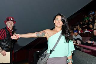 WOmen showing her arm tattoo at Flight 913 event