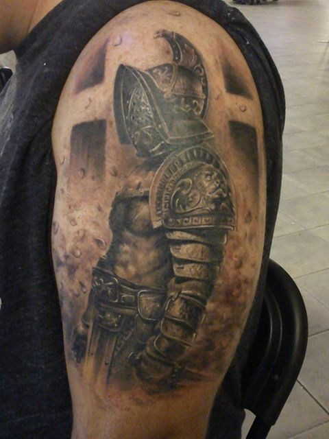 Customer showing his big tattoo on shoulder