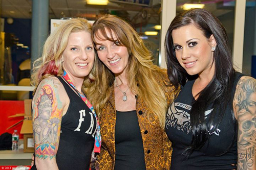 Tattoo artists with her friends at Flight 913 event