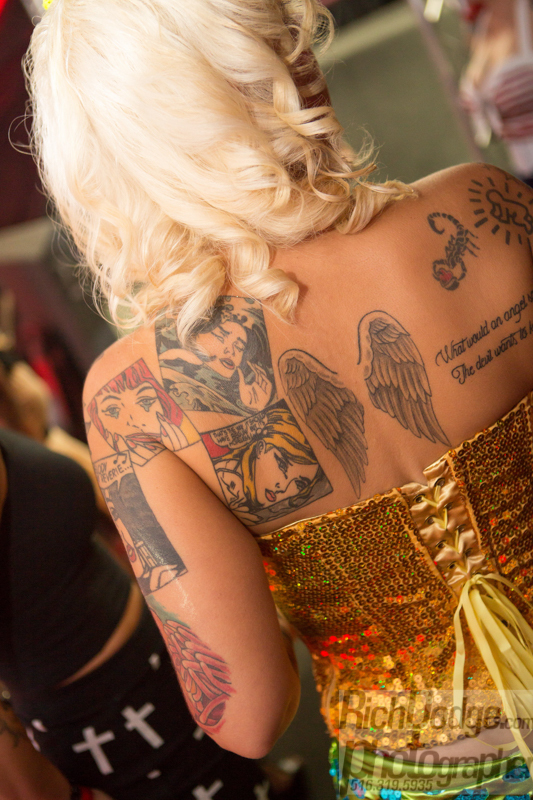 Women with back tattoo work on display