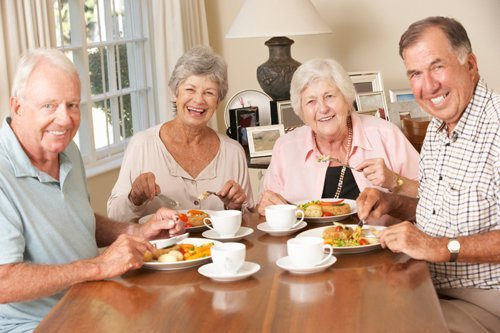 Elderly people having fun among themselves