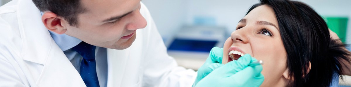 alstonville family dental dentist operates on patients teeth