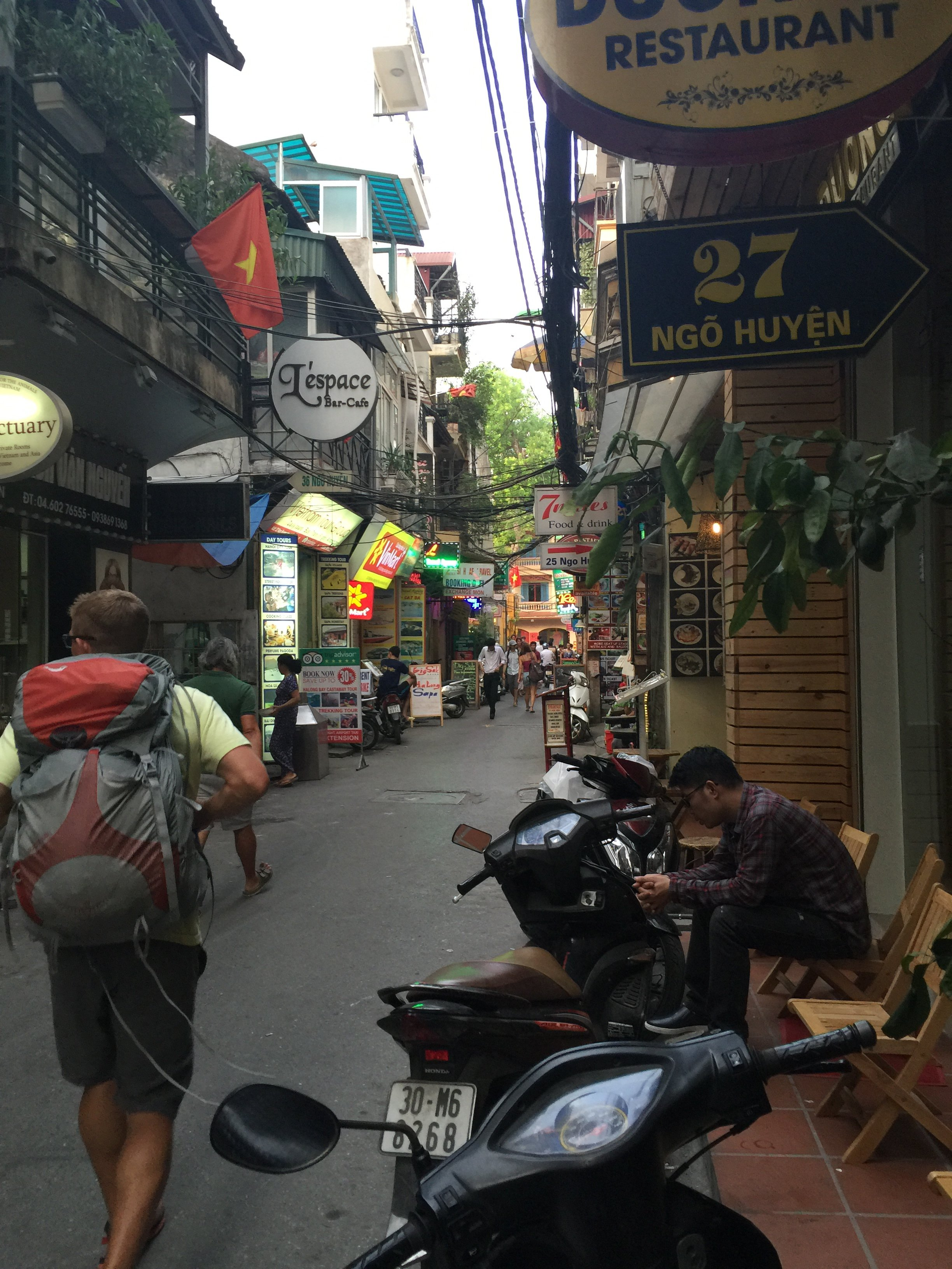 Backpacker walking through crowded streets of Vietnam