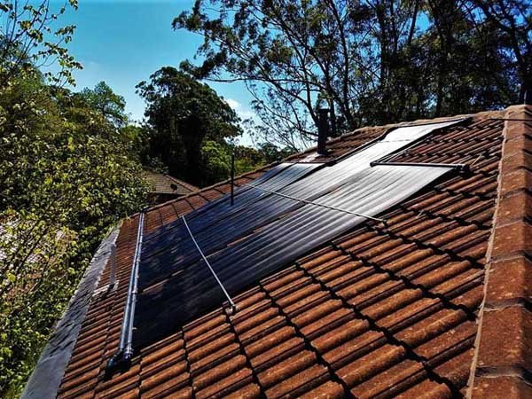 dark red roof with black solar panels