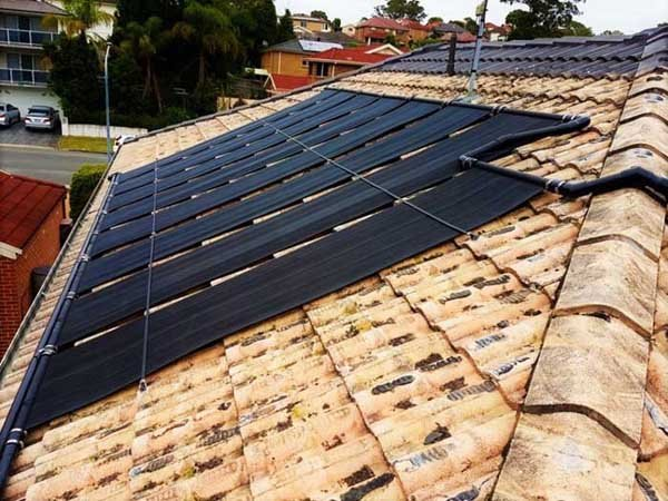 solar panels on light brown roof for pool