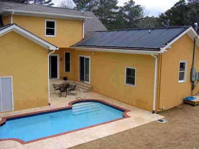solar pool panels on yellow house