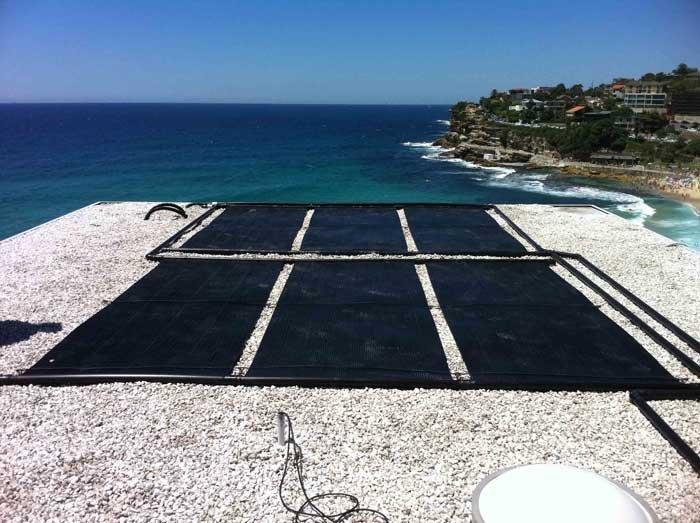 six solar panels on beach