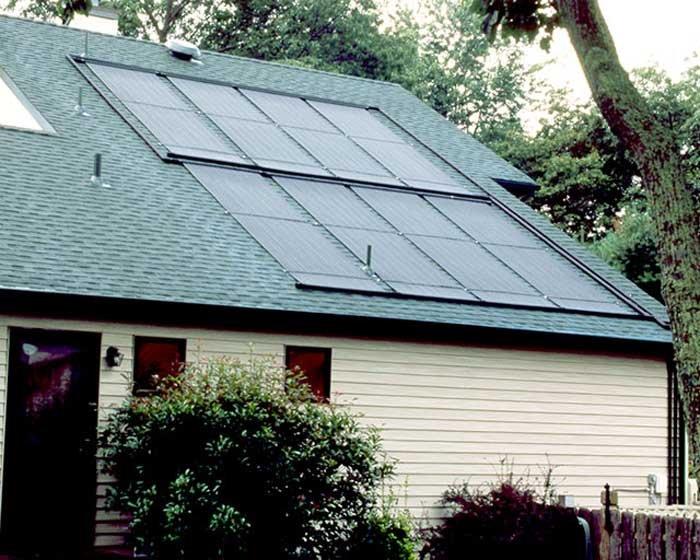 eight solar panels on green roof