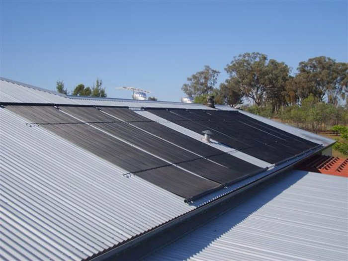 solar panels on top of tin roof