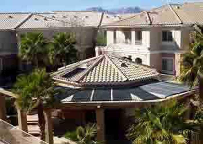 mansion with solar panels on gazebo