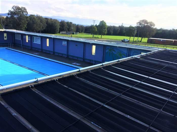 commercial pool heated by solar panels